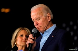 FILE - Democratic presidential candidate and former Vice President Joe Biden is accompanied by his wife Dr. Jill Biden.