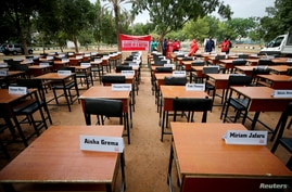 FILE PHOTO: Names of missing Chibok school girls kidnapped by Boko Haram insurgency five years ago are displayed during the 5th…