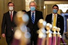 Senate Majority Leader Mitch McConnell (R-KY) walks to the Senate Chamber before a cloture vote on overriding the veto on the…