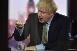 Britain's Prime Minister Boris Johnson gestures on BBC TV's The Andrew Marr Show in London, Britain January 3, 2021. Picture…
