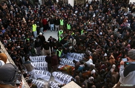 People and family members gather to identify the bodies of their relatives, who were coal miners from Pakistan's minority Shi…