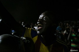 A supporter of Central African Republic's United Hearts Movement (MCU) party celebrates the victory of President Faustin-Archange Touadera outside their party offices, in Bangui, Central African Republic, Jan. 4, 2021.