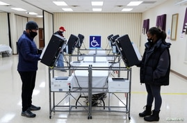 Voters cast their ballots in the U.S. Senate run-off election, at a polling station in Marietta, Georgia, Jan. 5, 2021.