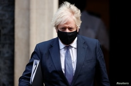 Britain's Prime Minister Boris Johnson leaves Downing Street, in London, Jan. 6, 2021.