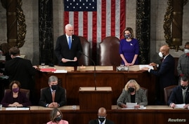 U.S. Vice President Mike Pence and Speaker of the House Nancy Pelosi (D-CA) take part in a joint session of Congress.