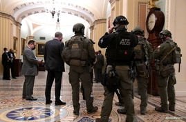 Police with the Alcohol, Tobacco and Firearms (ATF) maintain security in the halls of the Senate in the U.S. Capitol.