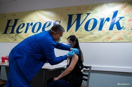Healthcare workers get vaccinated at the Trinitas Regional Medical Center in Elizabeth, New Jersey, U.S., January 8, 2021…