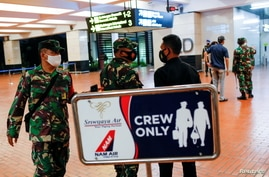 Indonesian soldiers are seen at Soekarno-Hatta International Airport after Sriwijaya Air plane flight SJ182 with more than 50 people on board lost contact after taking off, according to local media, in Tangerang, near Jakarta, Indonesia, Jan. 9, 2021.