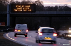 FILE PHOTO: A government public health information message is seen on a roadside sign, amidst the spread of the coronavirus…