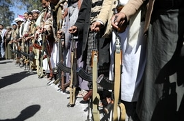 Houthi supporters hold their weapons during a demonstration outside the U.S. embassy against the United States over its…
