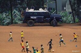 An Ugandan police APC (Armoured Personnel Carrier) is parked on a soccer field in Kampala, Uganda January 18, 2021. REUTERS/Baz…