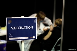 A senior citizen receives the Moderna coronavirus disease (COVID-19) vaccine at a vaccination center in Le Cannet, France,…