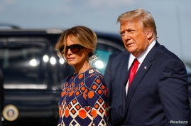 U.S. President Donald Trump and first lady Melania Trump arrive at Palm Beach International Airport in West Palm Beach, Florida.