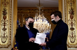 French President Emmanuel Macron meets historian Benjamin Stora for the delivery of the report on the memory of the…