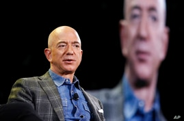 FILE - In this June 6, 2019, file photo Amazon CEO Jeff Bezos speaks at the the Amazon re:MARS convention in Las Vegas. Two U.N…