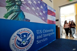 FILE - In this Aug. 17, 2018, file photo, people arrive before the start of a naturalization ceremony at the U.S. Citizenship…