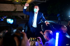 Pedro Pierluisi, gubernatorial candidate with the New Progressive Party (PNP), arrives at Vivo Beach Club to celebrate a slim…