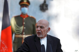 Afghan President Ashraf Ghani speaks during a joint news conference with Pakistan Prime Minister Imran Khan at the Presidential…