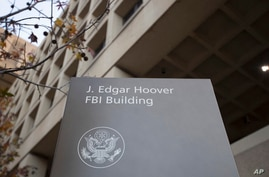 FILE - In this Nov. 30, 2017, file photo, the J. Edgar Hoover FBI building in Washington Lawyers for a former FBI lawyer who…