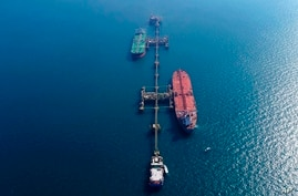 An aerial photo shows oil tankers load crude oil at Iraq's Al-Basra Offshore Terminal in Basra, Iraq, Sunday, Dec. 27, 2020. …