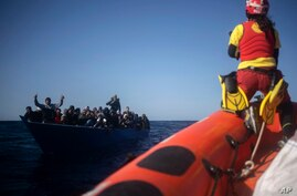 Migrants from Eritrea, Egypt, Syria and Sudan, are assisted by aid workers of the Spanish NGO Open Arms.