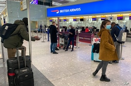 British travelers returning to their homes in Spain wait to speak to airline staff after they were refused entry onto planes.