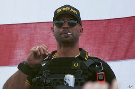 """FILE - In this Sept. 26, 2020, file photo, Proud Boys leader Henry """"Enrique"""" Tarrio wears a hat that says The War Boys during a…"""