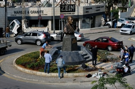 People gather near a statue of Iranian General Qassem Soleimani, who was the head of Iran's Quds force, that was installed to…