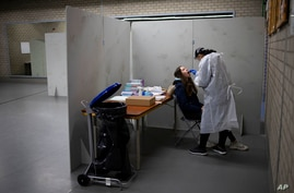 Residents of Bergschenhoek, Netherlands, take part in a mass test of all of the municipality's 62,000 residents starting…