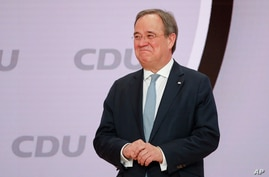 The new elected Christian Democratic Union, CDU, party chairman Armin Laschet stands on the podium after the voting at a…