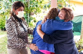 Elvira Carvajal, right, hugs Blanca Flores, as Irma Durand, left, cries after watching the swearing-in ceremony for Joe Biden…