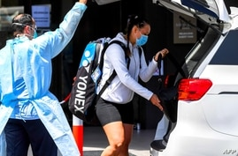 Australian tennis player Ivana Popovic leaves a hotel for a training session in Melbourne, Jan. 19, 2021, as players train while quarantining for two weeks ahead of the Australian Open tennis tournament.