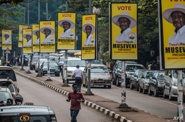 Billboards of Uganda's President Yoweri Museveni who is running for his 6th presidential term are seen on a street in Kampala, Jan. 4, 2021.