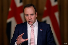 Britain's Health Secretary Matt Hancock speaks at a press conference inside 10 Downing Street on further restrictions to be put in place due to the ongoing coronavirus pandemic in London, Dec. 23, 2020.
