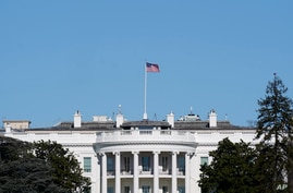FILE - An American flag flies above the White House in Washington, Jan. 9, 2021.