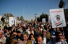 Houthi supporters chant slogans during a rally outside the closed U.S. embassy over obver the decision of the Trump administration to designate the Houthis a foreign terrorist organisation, in Sana'a, Yemen, Jan. 18, 2021.