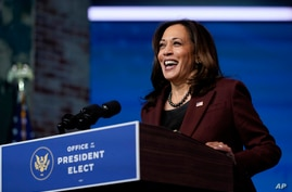 FILE - Vice President-elect Kamala Harris speaks at The Queen theater, in Wilmington, Delaware, Nov. 24, 2020.