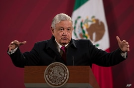 FILE - Mexican President Andres Manuel Lopez Obrador gives his daily morning news conference at the presidential palace, in Mexico City, Dec. 18, 2020.
