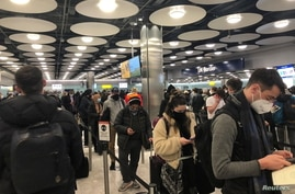 FILE - People queue at terminal 5 of Heathrow Airport, in London, Britain, Jan. 22, 2021, in this image obtained from social media. (Pia Josephson/via Reuters)