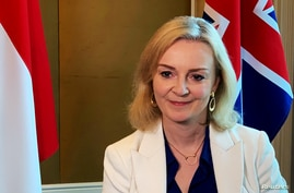 FILE - British trade minister Liz Truss speaks to Reuters after signing a free trade agreement with Singapore, in Singapore, Dec. 10, 2020.