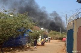 Smoke rises from a fighting between the Somali federal army and Jubbaland state forces in Beled Hawo, in the Gedo region of Somalia, Jan. 25, 2021, in this image obtained via social media.