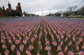 Thousands of U.S. flags are seen at the National Mall, as part of a memorial paying tribute to the U.S. citizens who have died from the COVID-19, near the Capitol ahead of President-elect Joe Biden's inauguration, in Washington, D.C.