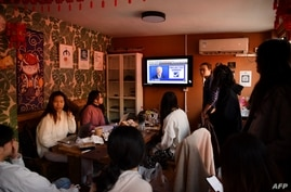 A group of Chinese students who study at US universities watch online live coverage of the US presidential election at an…