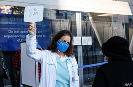Dr. Maria Ansari directs people in line at the mass vaccination site at San Francisco's Moscone Convention Center that opened…