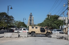 Empty streets are seen with blockades on February 8, 2021 on Champs de Mars in Port-au-Prince. - Haitian opposition parties…