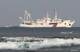 China Coast Guard vessels are pictured at the disputed Scarborough Shoal, April 5, 2017. Picture taken April 5, 2017.   …