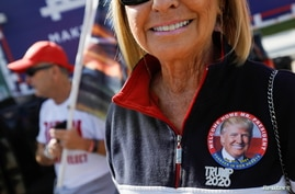 A pin depicting outgoing U.S. President Donald Trump is seen attached to his supporter, in West Palm Beach, Florida.