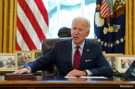 FILE PHOTO: U.S. President Joe Biden speaks before signing executive orders strengthening access to affordable healthcare at…