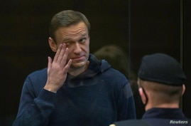 Russian opposition leader Alexei Navalny, accused of flouting the terms of a suspended sentence for embezzlement, attends a court hearing in Moscow, Russia, Feb. 2, 2021.