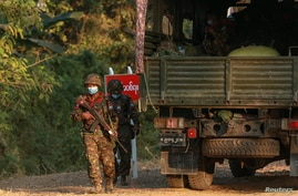 Myanmar's soldiers walk near the congress compound in Naypyitaw, Myanmar, February 2, 2021. REUTERS/Stringer NO RESALES NO…